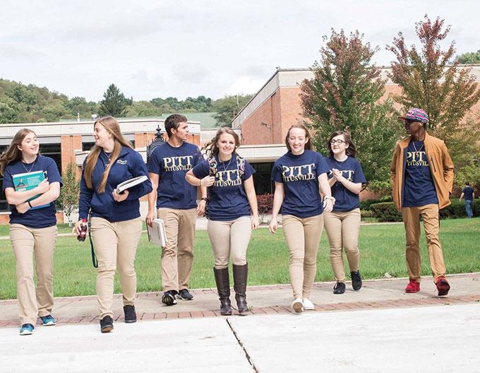 Pitt Titusville students walk through campus together
