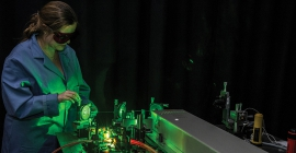 A student researcher works in a lab