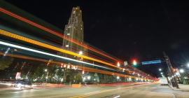 Forbes Avenue at night with the Cathedral of Learning