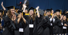 Pitt graduates celebrate in their caps and gowns