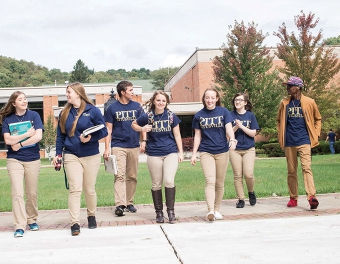 Pitt Titusville students walk through campus together